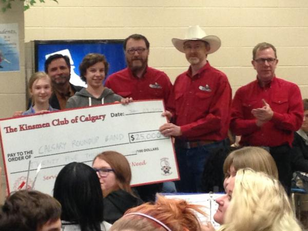 Calgary Kinsmen Present a $25,000 cheque to Calgary round up Band